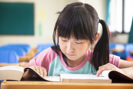 picture of a girl having psle tuition