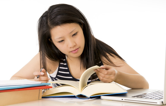 a student having jc gp tuition and doing homework given by her tutor